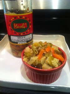 Hot giardiniera in red serving bowl